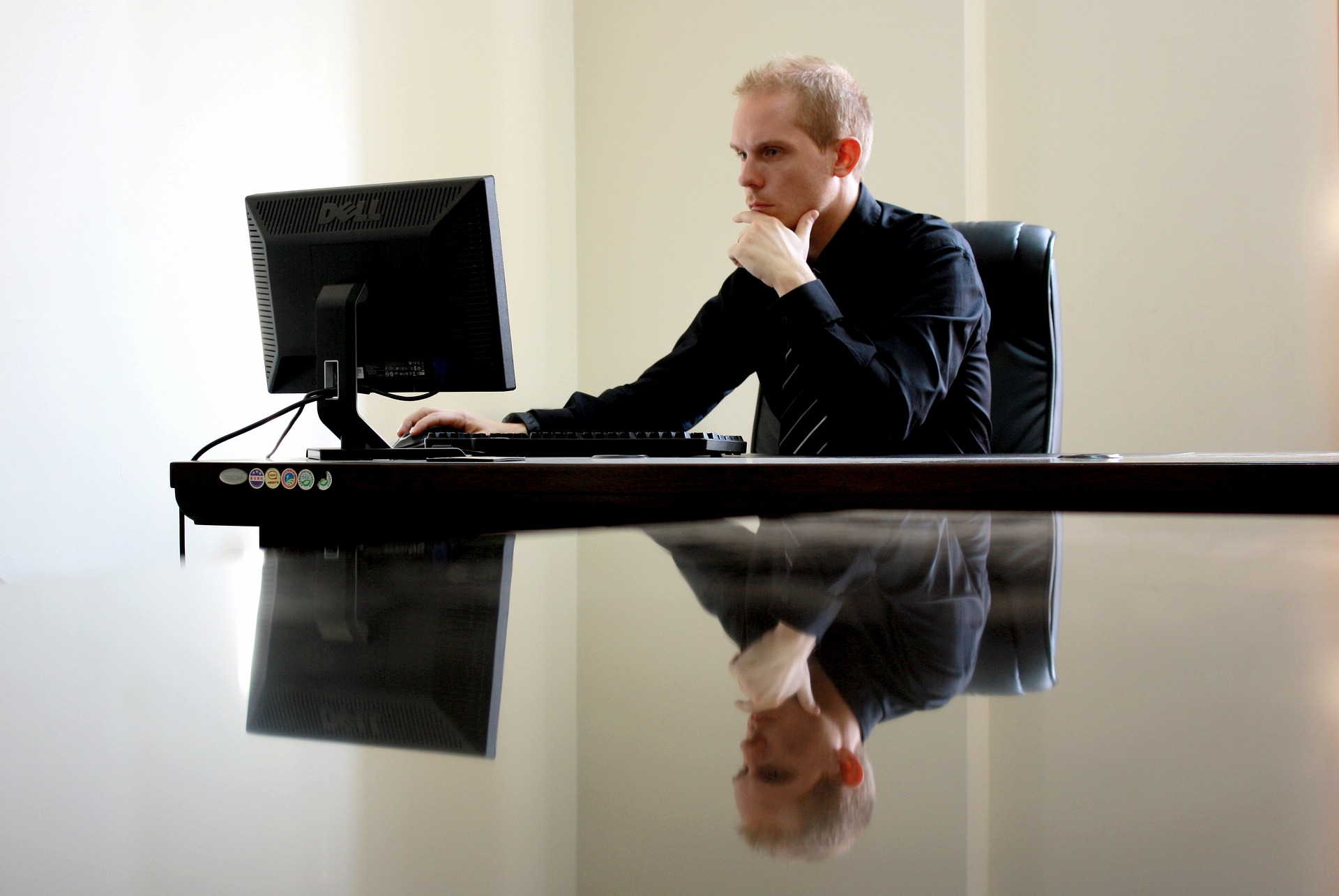 man at computer desk