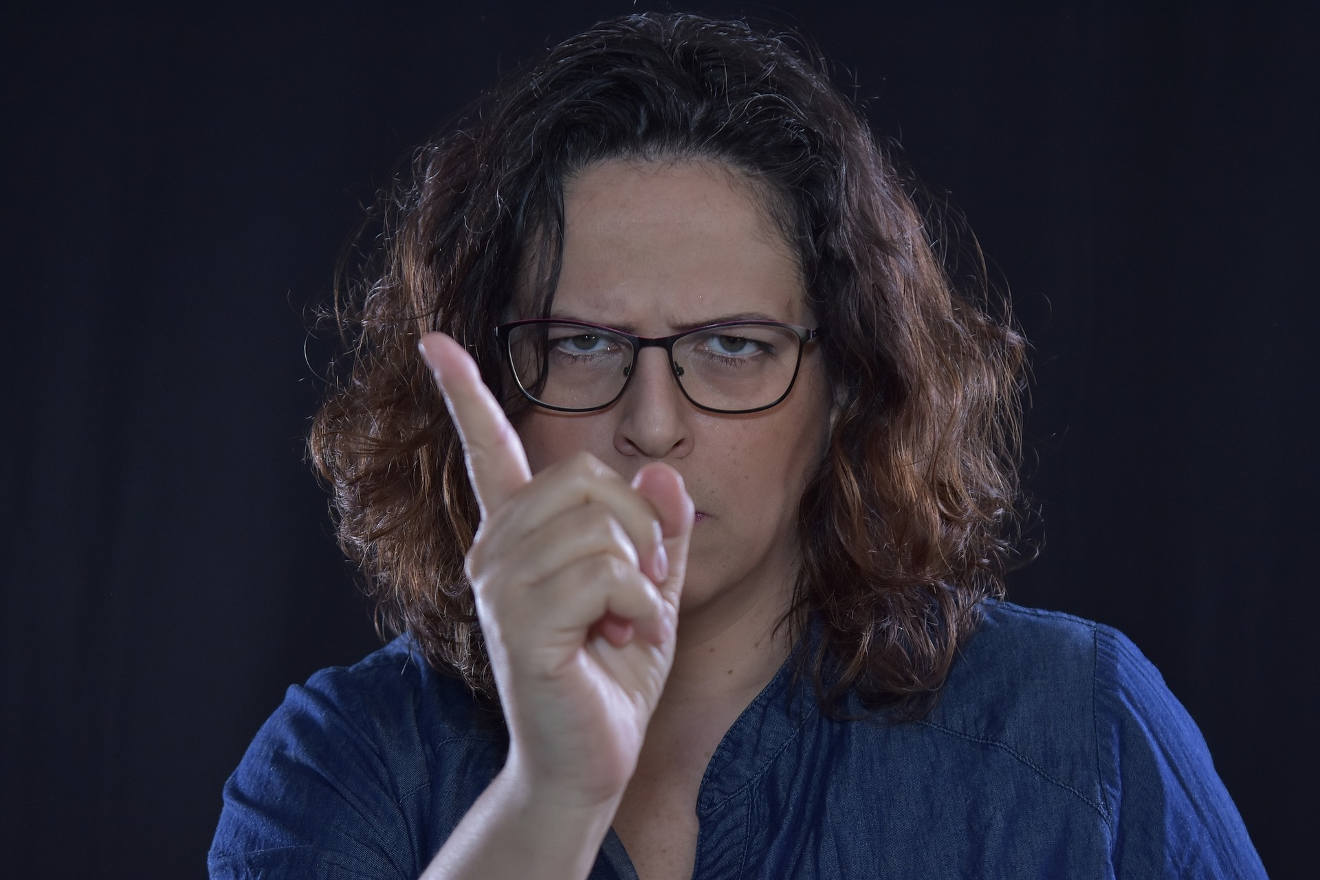 woman pointing finger sternly